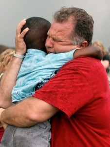 A teacher hugs a child at Briarwood Elementary School after a tornado destroyed the school in Oklahoma City on Monday.(Photo: Paul Hellstern, The Oklahoman via AP)
